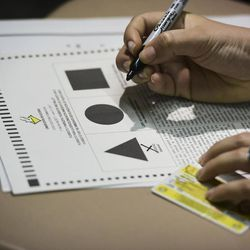 A Puerto Rican citizen votes during the fifth referendum in San Juan, Puerto Rico, Sunday, June 11, 2017. Residents of the U.S. Territory had to choose between the options of statehood, free association/independence and current territorial status.