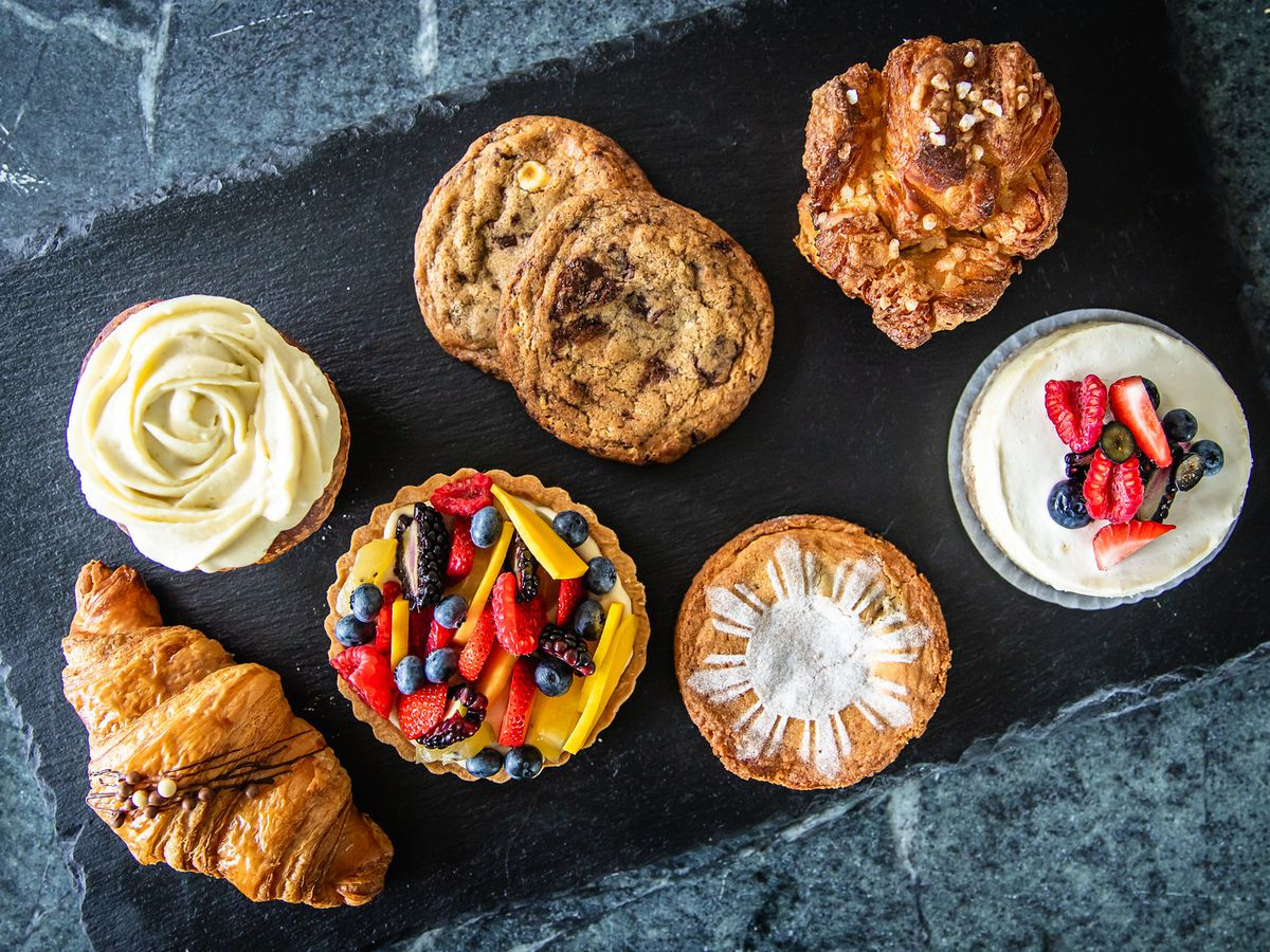 A plate of cookies, croissants, cakes, and more.