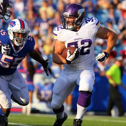 Aug 16, 2013; Orchard Park, NY, USA;  Minnesota Vikings running back Toby Gerhart (32) runs the ball to avoid getting tackled by Buffalo Bills outside linebacker Jerry Hughes (55) during the first quarter at Ralph Wilson Stadium.