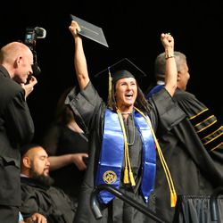 Lisa Hancock cheers after receiving her degree during Salt Lake Community College's commencement ceremony at the Maverik Center in West Valley City on Friday, May 6, 2016.