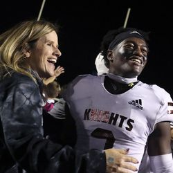 Lone Peak's Luke Hyde celebrates with his mom Wendy after their win against Corner Canyon at Corner Canyon High School in Draper on Thursday, Oct. 7, 2021.