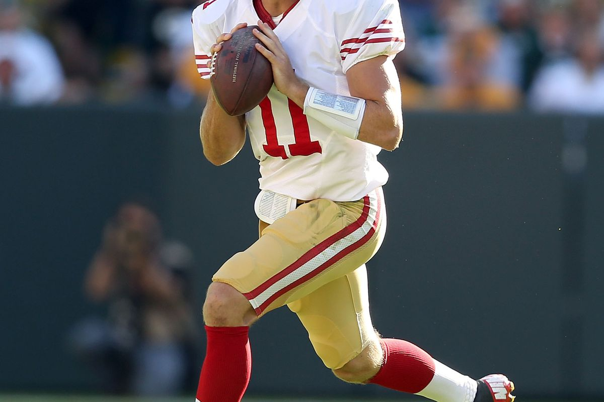 GREEN BAY, WI - SEPTEMBER 09:  Alex Smith #11 of the San Francisco 49ers runs with the ball during the NFL season opener against the Green Bay Packers at Lambeau Field on September 9, 2012 in Green Bay, Wisconsin.  (Photo by Andy Lyons/Getty Images)
