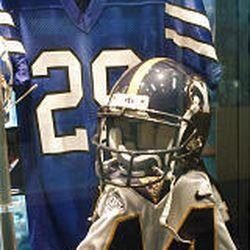 Jamal Willis' early 1990s uniform (29) hangs near the uniform of Rob Morris' 1999 jersey (44).