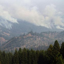 The Table Mountain Complex Fire, viewed from near Cle-Elum, Wash., continues to burn, Thursday, Sept. 20, 2012.  A combination of factors — including warm temperatures, winds, very low humidity and low moisture in the vegetation — caused the complex to grow and merge into one large fire on Wednesday, fire spokeswoman Jan Ulrich said.