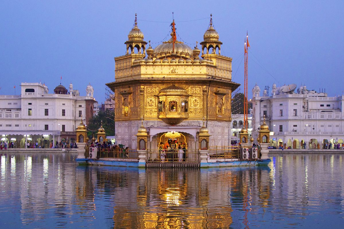 """The exterior of the <span data-author=""""843"""">Harmandir Sahib in India. The facade is gold and ornately decorated.</span>"""