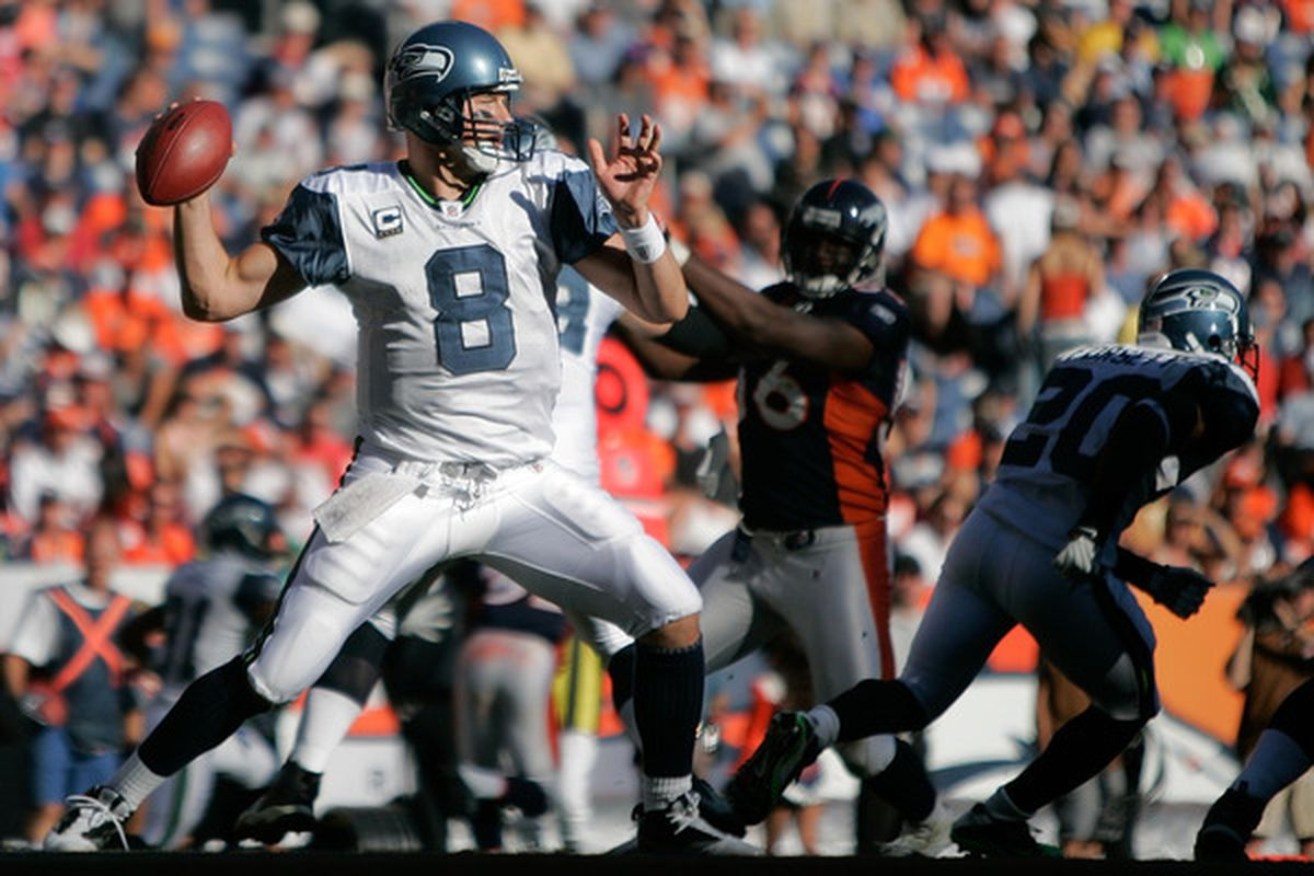 DENVER - SEPTEMBER 19:  Quarterback Matt Hasselbeck #8 of the Seattle Seahawks makes a pass against the Denver Broncos during NFL action at INVESCO Field at Mile High on September 19 2010 in Denver Colorado.  (Photo by Justin Edmonds/Getty Images)