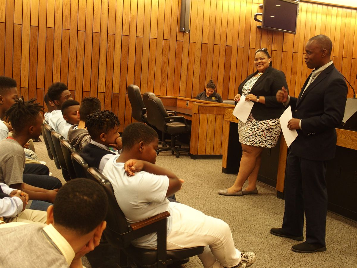 County commissioners Tami Sawyer and Van Turner talk to students at Grizzlies Prep charter school.
