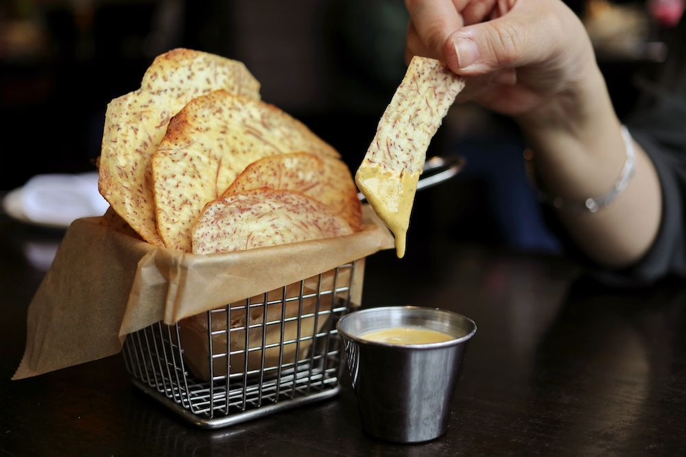 A metal basket with taro chips.