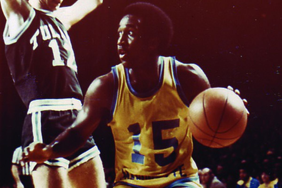 Butch Lee in the gold version of Marquette's famous untucked jerseys from the 1977 championship run.