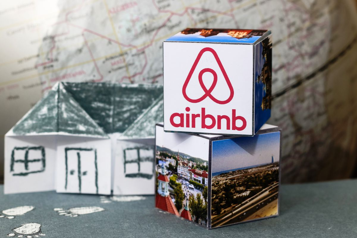 An origami house with an Airbnb logo