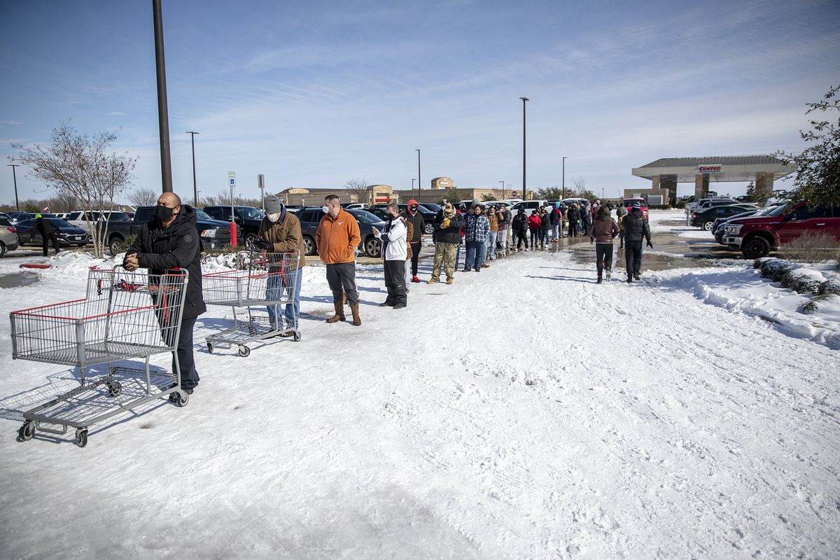 People line up to enter Costco in Pflugerville, Texas, Tuesday morning, Feb 16, 2021.