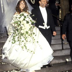 Mariah Carey, in true Mariah Carey fashion, opted for a $25,000 Vera Wang gown with a 27-foot-long train at her June 5th, 1993 wedding to Tommy Mottola.