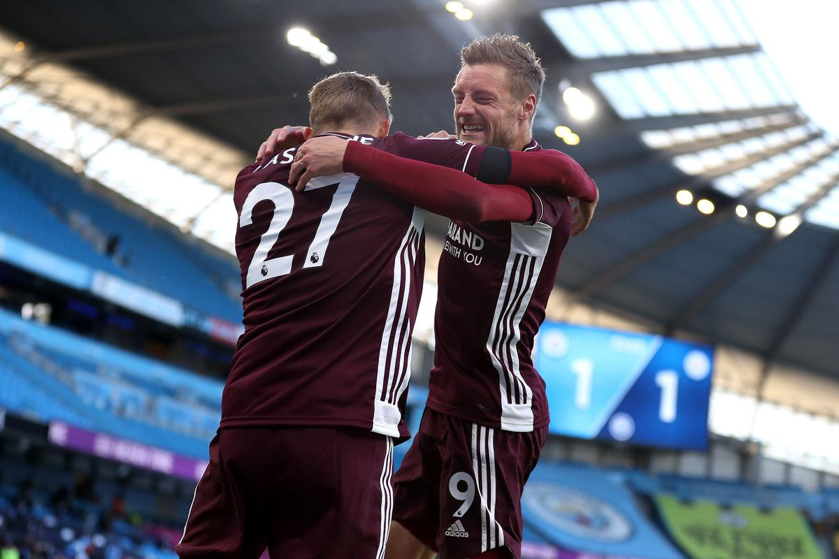 Manchester City v Leicester City - Premier League Castagne, back to the camera, hugs a grinning Vardy with the empty Etihad visible behind them