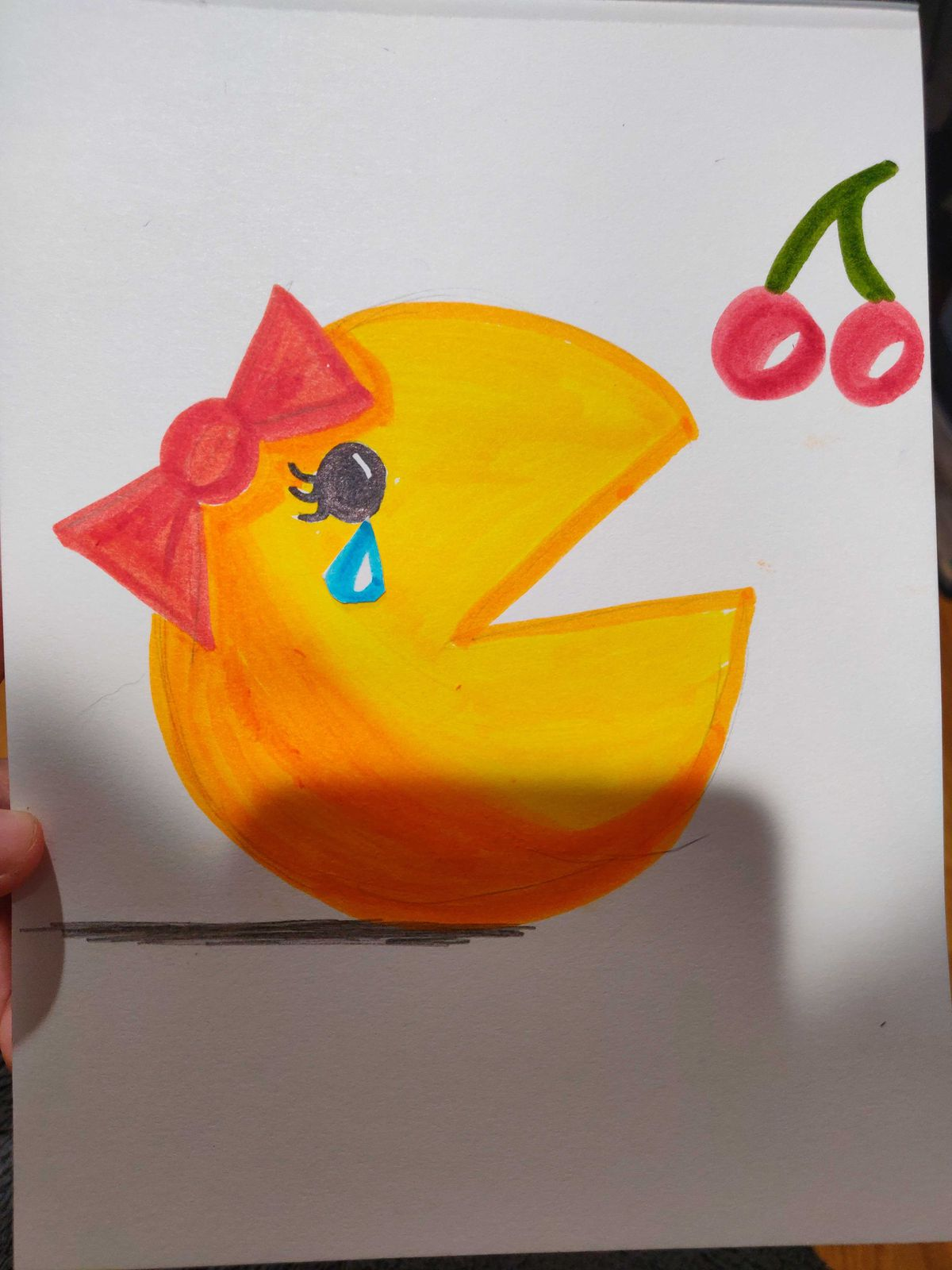 Ms. Pac-Man reaches in vain for a cherry power-up as a tear rolls down her cheek