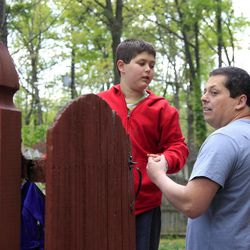 Stuart Chaifetz stands with his son Akian Chaifetz, 10, at their home in Cherry Hill, N.J., Wednesday, April 25, 2012. Chaifetz was told that his son Akian was acting violently at his New Jersey school  so he decided to investigate. Akian has autism, as do the rest of the students in the class. This prevented him from being able to explain to his father if anything had been happening to him at school. Chaifetz decided the only way to find out what was behind the outbursts was to send his boy to school wearing a hidden audio recorder.