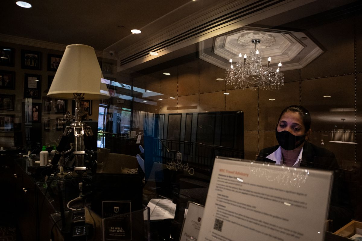 Marilyn Escudero, 41, is often the first and last person guests at the Fitzpatrick Grand Central Hotel come in contact with, Aug. 28, 2020.
