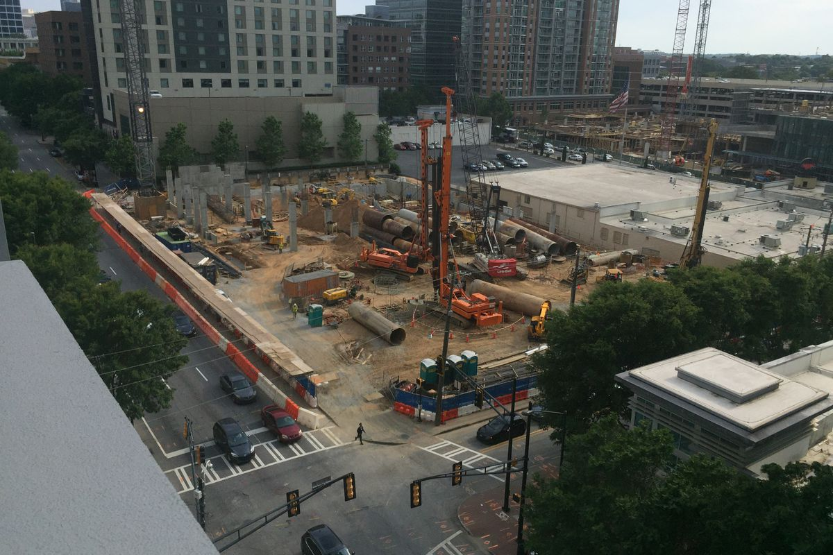 An aerial view of the construction site, with columns rising from the ground.