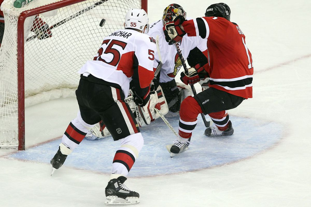 Pictured: Stephen Gionta scoring the game winning goal with some no-defense by Sergei Gonchar.  Mandatory Credit: Ed Mulholland-US PRESSWIRE
