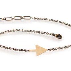 "Zoe Chicco bracelet, <a href=""http://zoechicco.com/products/mixed-flat-arrowhead-bracelet"">$154</a>"