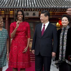 With Chinese president Xi Jinping in red Naeem Khan. Images via Getty.