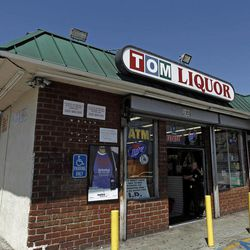 This April 20, 2012 photo shows Tom's Liquor at the corner of Florence and Normandie in Los Angeles. Twenty years since the 1992 LA riots residents of the city's largely black and Hispanic South Side complain that the area still is plagued by too few jobs, too few grocery stores and a lack of redevelopment that would bring more life to the area.