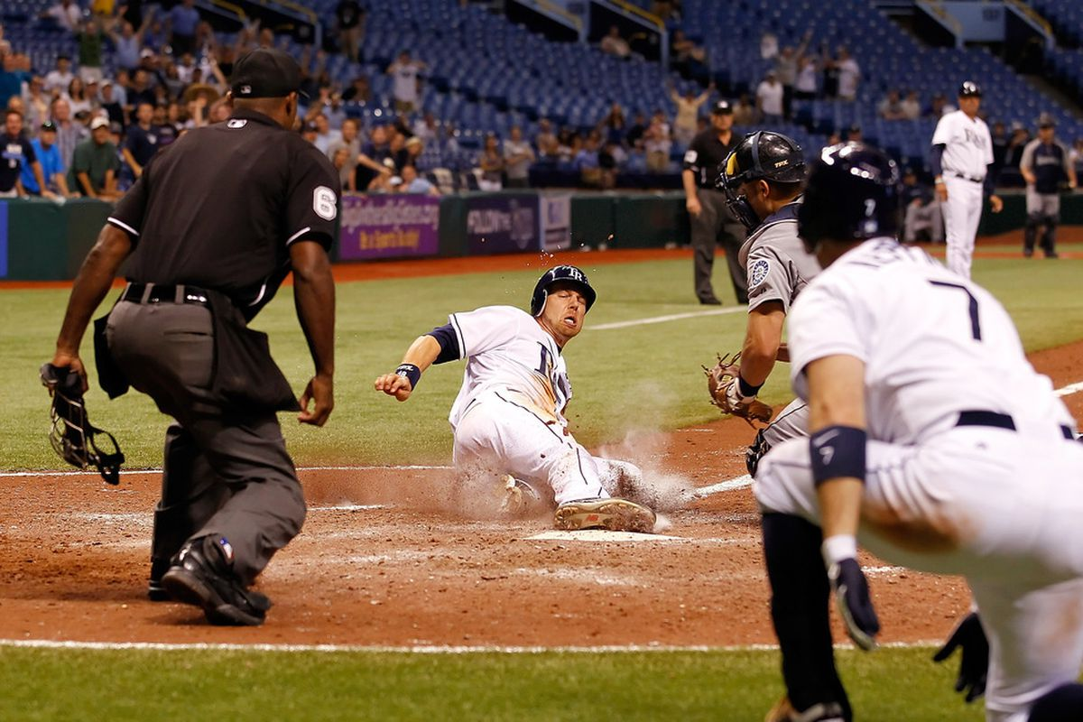 ST PETERSBURG, FL - APRIL 30:  Infielder Ben Zobrist #18 of the Tampa Bay Rays scores the game winning run against the Seattle Mariners at Tropicana Field on April 30, 2012 in St. Petersburg, Florida.  (Photo by J. Meric/Getty Images)