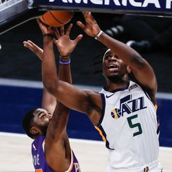 Utah Jazz forward Jarrell Brantley (5) makes a layup attempt against Phoenix Suns forward Mikal Bridges (25) during an NBA preseason game at Vivint Smart Home Arena in Salt Lake City on Saturday, Dec. 12, 2020.