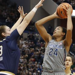 UConn's Napheesa Collier (24) shoots over Notre Dame's Jessica Shepard (23) during the Notre Dame Fighting Irish vs UConn Huskies women's college basketball game in the Women's Jimmy V Classic at the XL Center in Hartford, CT on December 3, 2017.