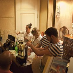 Representatives from St. Germain making the classic St. Germain cocktail (rose water, St. Germain, and sparkling water) at the exit of the Hotel Monteleone.