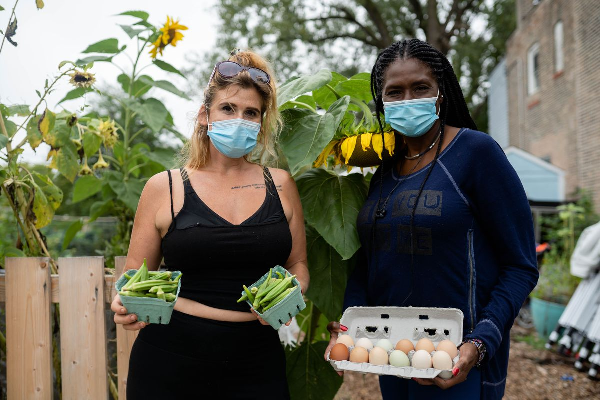 Stephanie Dunn (l), owner of Star Farm in Chicago's Back of the Yards neighborhood, and Johari Cole-Kweli, owner of Iyabo Farms in Pembroke Township, are among 27 Illinois farmers that recently received $250,000 in grants to meet skyrocketing demand for local food spurred by the pandemic. Cole-Kweli regularly drives up to deliver eggs and produce to Dunn.