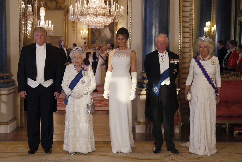 President Donald Trump, Queen Elizabeth II, First Lady Melania Trump, Prince Charles and Camilla, the Duchess of Cornwall, pose for the media ahead of the state banquet at Buckingham Palace in London on June 3, 2019.
