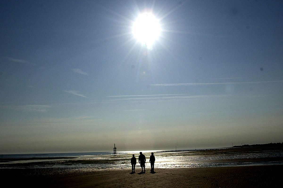 People Walk Along Juno Beach During 59th Anniversary Of D-Day in France