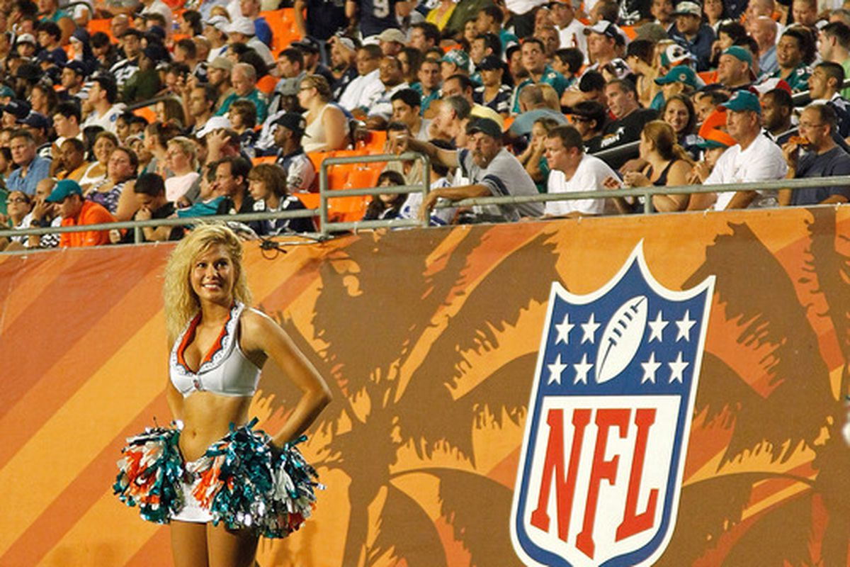 MIAMI GARDENS, FL - SEPTEMBER 01:  A Miami Dolphins cheerleader looks on during a Pre-Season NFL game against the Dallas Cowboys at Sun Life Stadium on September 1, 2011 in Miami Gardens, Florida.  (Photo by Mike Ehrmann/Getty Images)