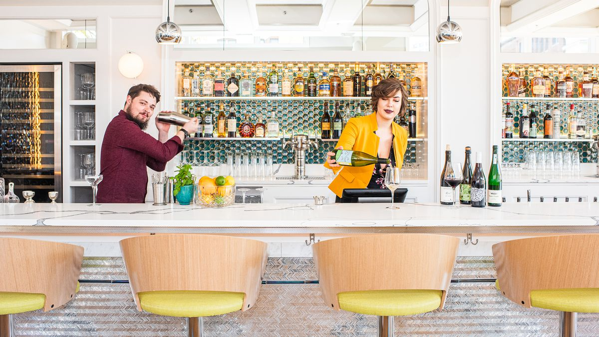 Beverage director Andy Bixby, left, and sommelier Morgan Kirchner prepare drinks at the Imperial's first-floor bar