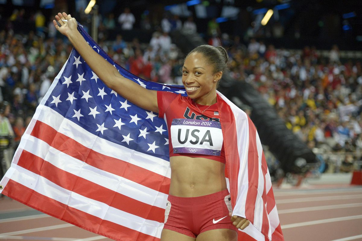 Aug 11, 2012; London, United Kingdom; Allyson Felix (USA) celebrates with an American flag after winning the women's 4x400m relay final during the 2012 London Olympic Games at Olympic Stadium. Mandatory Credit: Kirby Lee-USA TODAY Sports