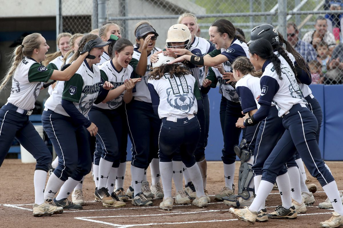 Makaiya Gomez is greeted at home plate by her Copper Hills teammates after blasting a two-run homer during the 6A semifinal softball game against Herriman at the SLCC softball field in Taylorsville on Monday, May 27, 2019.