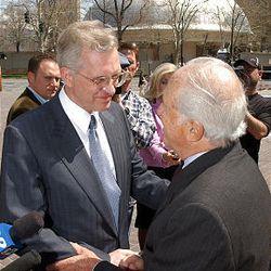 Elder D. Todd Christofferson, left, and Jewish spokesman Ernest W. Michel shake hands in 2005.