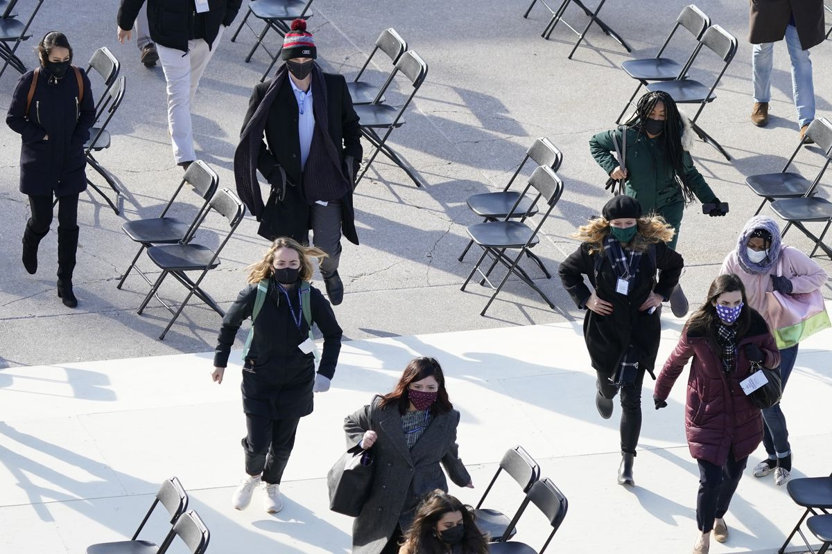 People evacuate from the West Front of the U.S. Capitol during a rehearsal the 59th Presidential Inauguration at the U.S. Capitol in Washington, Monday, Jan. 18, 2021.