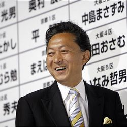 Yukio Hatoyama, leader of the main opposition Democratic Party of Japan reacts while observing the result of parliamentary elections at the Democrats election center in Tokyo Sunday.