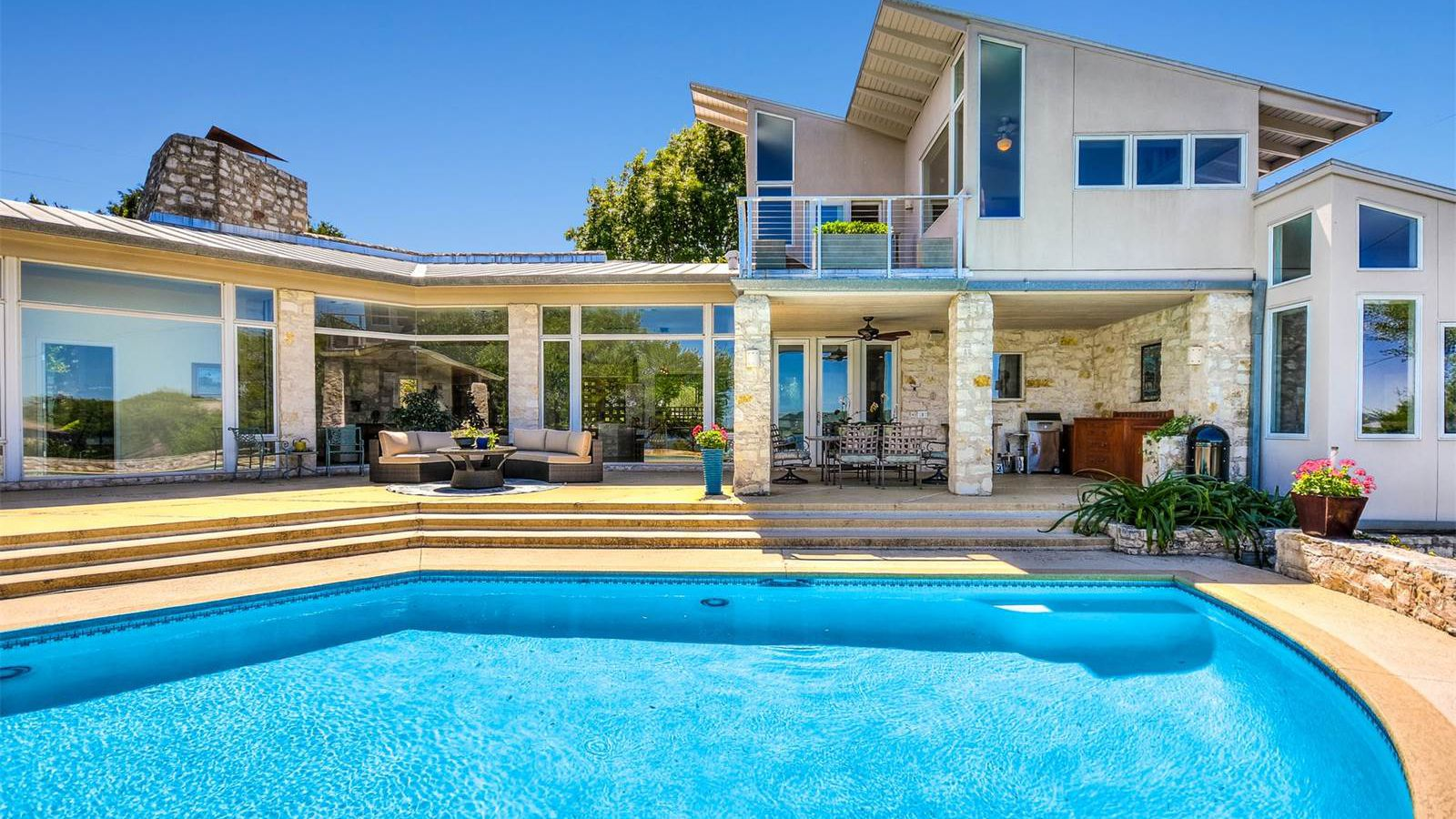 Stylish lake travis contemporary asks 1 2m curbed austin for Contemporary homes for sale in austin