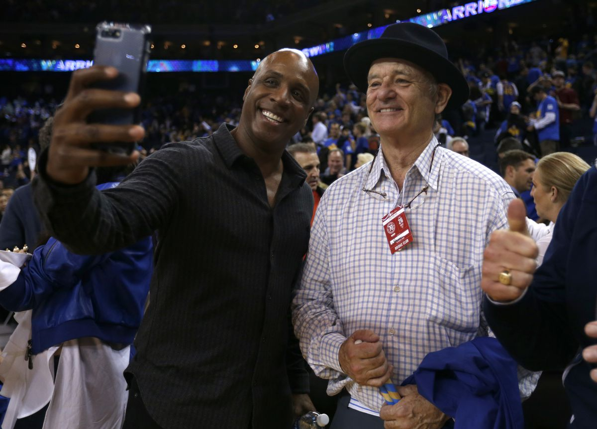 Former San Francisco Giants' Barry Bonds takes a selfie with actor Bill Murray after the Golden State Warriors 123-92 win against the Chicago Bulls at Oracle Arena in Oakland, Calif. on Wednesday, Feb. 8, 2017. (Nhat V. Meyer/Bay Area News Group)