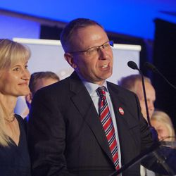 Doug Owens, with his wife, Cynthia, and family at his side, concedes the race for the 4th Congressional District Tuesday, Nov. 4, 2014, in Salt Lake City.