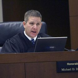 Judge Michael DiReda talks with lawyers during the hearing on Jan. 18 for Debra Brown, who was declared innocent in the 1993 killing of her boss and friend, Lael Brown.