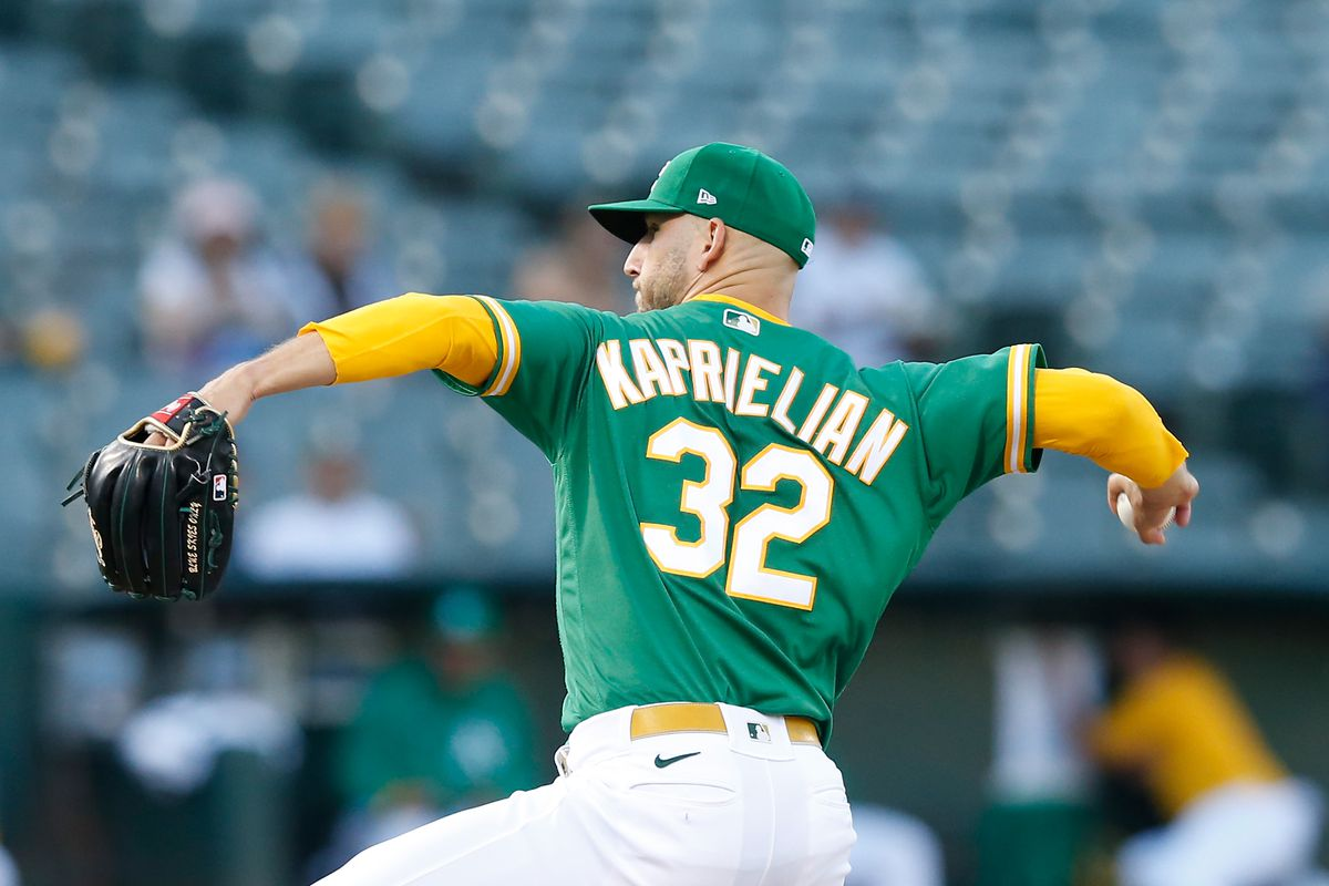 James Kaprielian #32 of the Oakland Athletics pitches in the top of the first inning against the New York Yankees at RingCentral Coliseum on August 26, 2021 in Oakland, California.