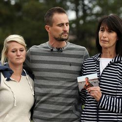 Russell Jacobs' niece Kallie Stolk, left, nephew Brian Stolk and Lyne Miller, a cousin to Jacobs' wife, speak at a press conference Friday, Oct. 30, 2015 in East Millcreek. Miller holds a photo of Jacobs, who died after being shot Oct. 29, 2015.