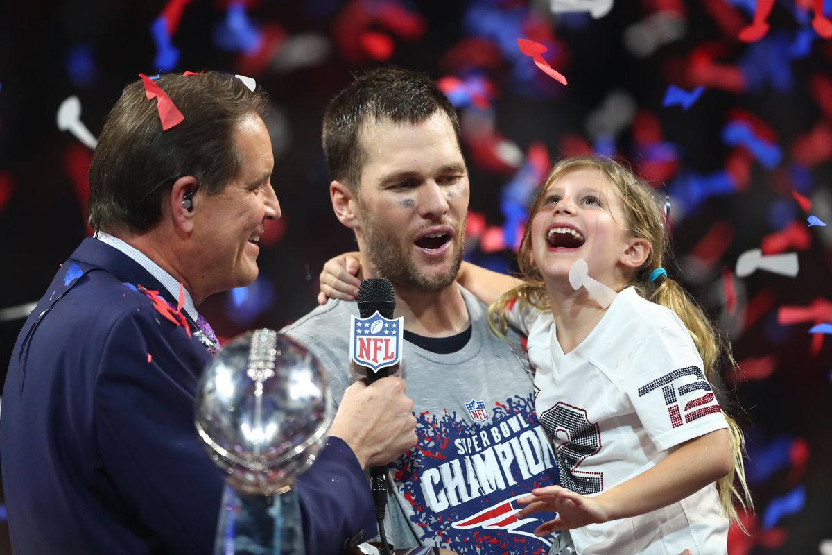 New England Patriots quarterback Tom Brady is interviewed by CBS host Jim Nantz with the Vince Lombardi Trophy after defeating the Los Angeles Rams in Super Bowl LIII at Mercedes-Benz Stadium.