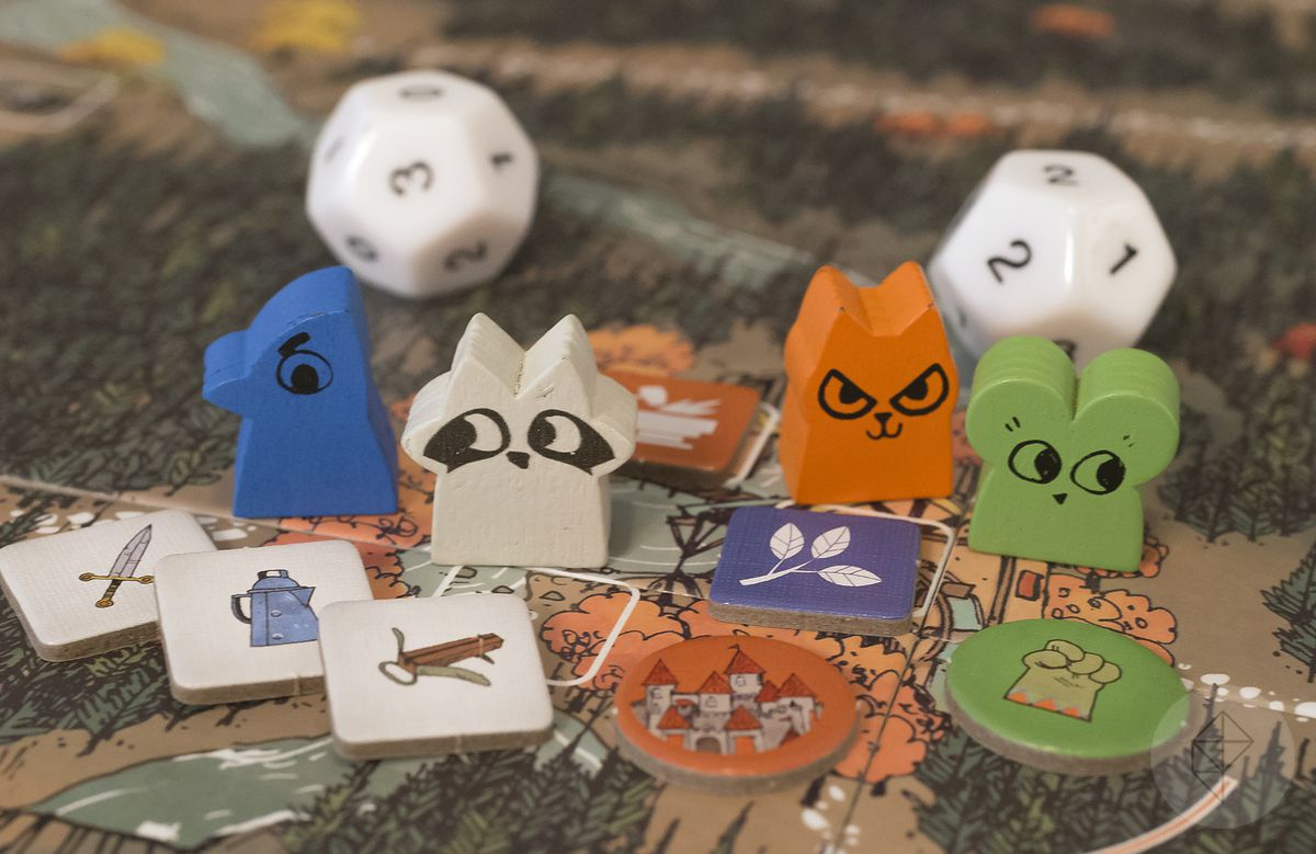 Gen Con 2018 — Wooden pawns from Root, each with adorable printed facial features.