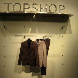 Men's blazer, $280. Button-down shirt, $52. Pants, $120.
