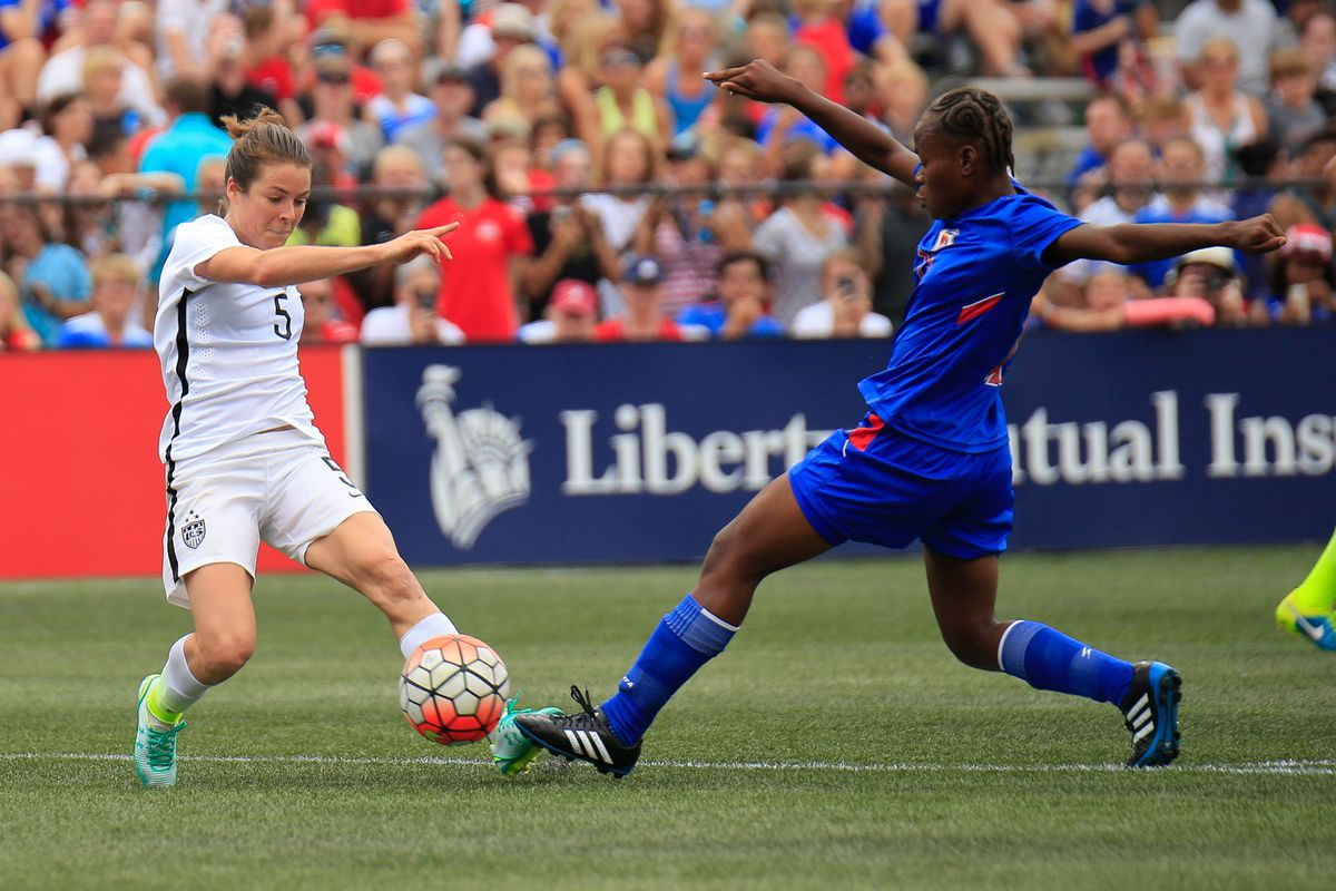 Sky Blue and United States player Kelley O'Hara (5) goes for the ball against a Haiti defender during the match at Legion Field.