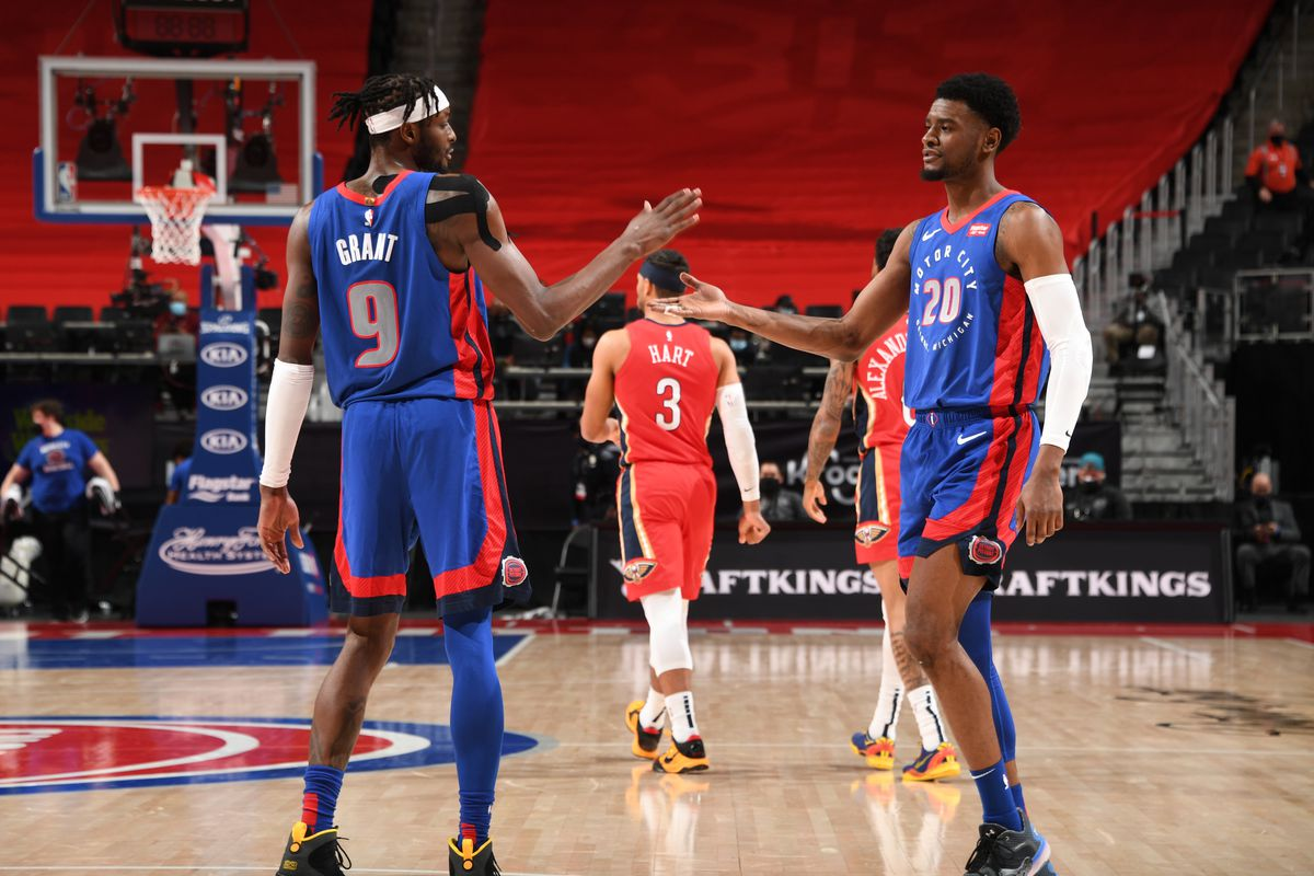 Jerami Grant and Svi Josh Jackson of the Detroit Pistons hi-five during the game against the New Orleans Pelicans on February 14, 2021 at Little Caesars Arena in Detroit, Michigan.